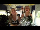 Alabama and Michigan State cheerleaders play cornhole from the Goodyear blimp