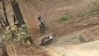 Man Tries to Climb Hill on Mini Dirt Bike