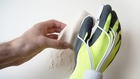 Electric Happaratus glove enables wood and stone to be sculpted by hand