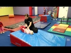 Gabby doing a backwards roll at Little Gym